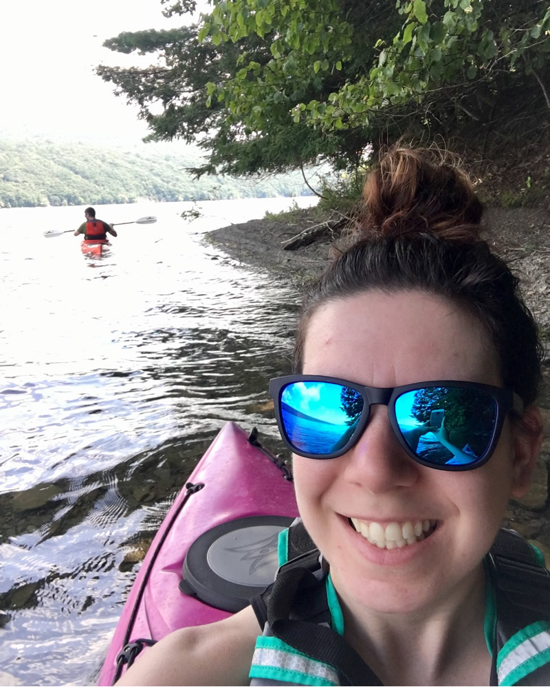 Katie kayaking in Hemlock Lake.