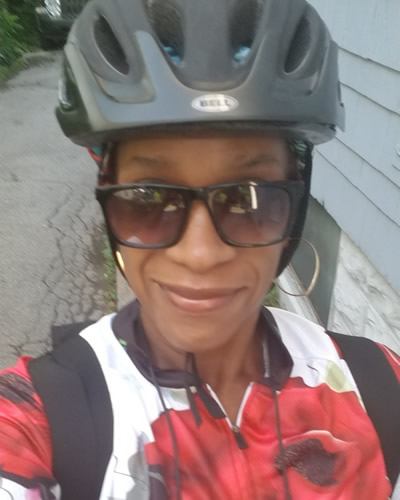 Vestina wearing a bicycle helmet and sunglasses.